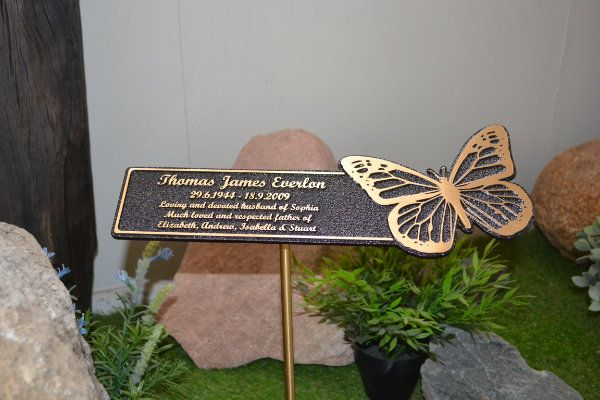 Floating bronze plaque